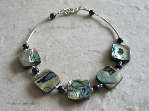 Blue & Green Abalone Paua Shell, Blue Swarovski Pearls & Sterling Silver Curves Bracelet